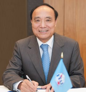 ITU-Secretary-General-Mr.-Houlin-ZHAO-with-Flaglet-279x300